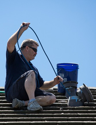 Randy cleaning a roof dryer vent